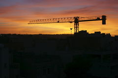Contruction Crane. On the sunset Stock Images