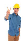 Contruction engineering student wearing helmet making the victor stock photo