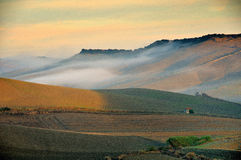 Contry foogy sunrise. Italian Contry foogy sunrise in the autumn morning Stock Photo
