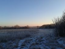 Contryside field in the morning. Very beatiful frosty sunrise Royalty Free Stock Image