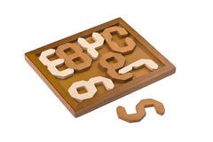Conundrum with numbers. Logical wooden puzzles to train your brain Stock Images
