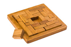 Conundrum on white. Logical wooden puzzles to train your brain Stock Photography