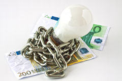 Convection electric lamp and money Stock Photos