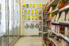 Convenience Store. Shelves of instant noodle, hanging dried snack and fridge door in the convenience store. Photo was taken on 26 October 2012 royalty free stock image