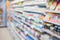 Convenience store shelves. Blurred background stock images