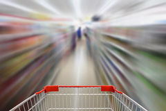 Convenience store shelves blurred background Stock Image