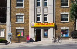 Convenience Store. TORONTO, CANADA - 3RD SEPTEMBER 2014: The outside of a convenience store in midtown Toronto during the day showing a Bell telephone terminal royalty free stock image