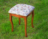 Convenient stool with the seat upholstered with a gobelin. Royalty Free Stock Photo