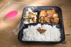 Convenient take-away meal box with rice, meat and vegetable Stock Photos