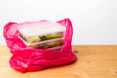 Convenient but unhealthy disposable plastic lunch boxes with mea Stock Image