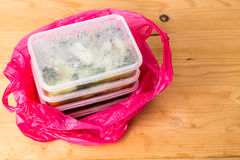Convenient but unhealthy disposable plastic lunch boxes with meals. Convenient but unhealthy disposable plastic lunch boxes with take away meal in plastic bag on royalty free stock image
