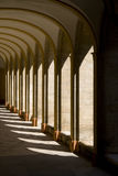Convent. Sunlight through arches of medieval convent falling on stones Stock Photos