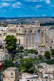 Convent of Saint Agostino from far and above. MATERA, ITALY - AUGUST 27, 2018: Warm scenery summer day high angle street view of amazing ancient town of the royalty free stock photos