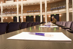 Convention center. With a person in the background - focus on the table in the foreground Royalty Free Stock Image