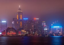 Convention Center and Central Plaza tower night skyline Hong Kong Island, China. Hong Kong Island, China - May 12, 2010: Partial night skyline with Convention royalty free stock image