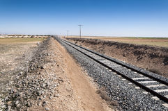 Conventional rail in an agricultural landscape Stock Photos