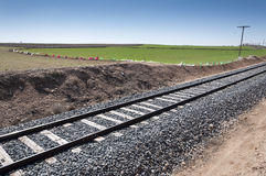 Conventional rail in an agricultural landscape Royalty Free Stock Images