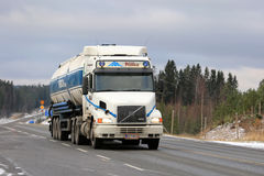 Conventional Volvo NH12 Semi Tanker on the Road Stock Photography