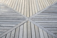 Convergence. The boards on a wood deck converge at an X Royalty Free Stock Image
