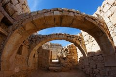Converging ancient stone arches Stock Images