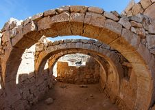 Converging ancient stone arches Royalty Free Stock Photos