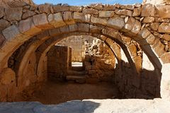 Converging ancient stone arches Stock Photo