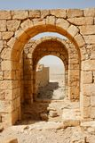 Converging ancient stone arches. Of ruined temple Royalty Free Stock Image