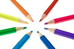 Converging Coloured Pencils. Eight coloured pencils pointing towards the same spot, isolated on white Stock Images