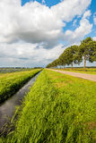 Converging lines in a Dutch polder landscape on a cloudy day Stock Photo