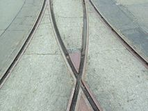 Converging Tracks. Converging train tracks in asphalt background royalty free stock photos