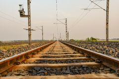Converging train lines into horizon royalty free stock photography
