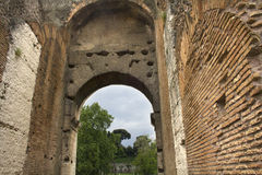 Converging walls of the Roman Coliseum. Architectural detail of the Roman Coliseum in Rome; Lazio; Italy, with converging brick walls and an open arch. The arch Stock Photos