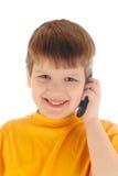 Conversa do menino em um telefone de pilha imagens de stock royalty free