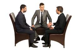 Conversación seria de los hombres de negocios Imagen de archivo libre de regalías