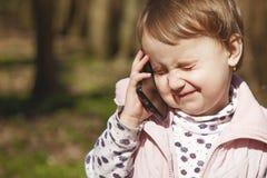 Conversación telefónica del negocio Muchacha hermosa s del niño del negocio imagen de archivo libre de regalías