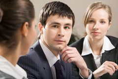 During conversation. Portrait of confident businessman looking at colleague with another woman near by Stock Photography