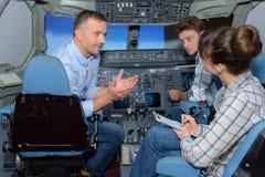 Conversation in aircraft simulator Royalty Free Stock Image