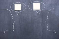 Conversation. Blackboard drawing of two people imitating conversation royalty free illustration