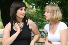 Conversation of the blonde and the brunette Stock Photography