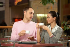 Conversation in cafe Royalty Free Stock Photos