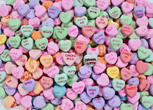 Conversation candy hearts. Background of colorful conversation candy hearts royalty free stock image