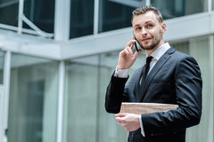 Conversation with the client. Confident businessman in formal co stock photography