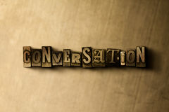 CONVERSATION - close-up of grungy vintage typeset word on metal backdrop Stock Photos