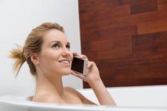 Conversation dans la baignoire Image libre de droits