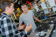 Conversation in disc jockey shop Stock Images