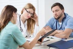 Conversation in doctors room Stock Photography