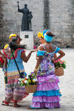 Conversation between Flower Girls in San Francisco Square in Havana stock images