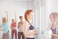 Conversation on a gym. Two active girls having conversation on a gym Royalty Free Stock Photography