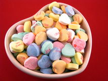 Conversation Hearts. Valentine conversation hearts in a heart shaped bowl stock image