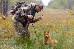 Conversation between hunter and dog Stock Images